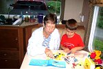 Grandma and Elijah building a Lego camper and tow vehicle.